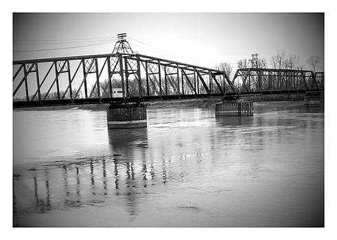 old train bridge over Missouri river. by Dustin Soph