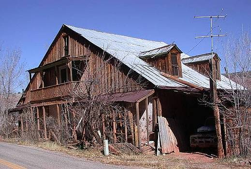 Old Truck and Old House in Jemez NM by Susan Boyes