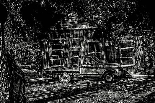 Old Truck with Old building by Bruce Bottomley