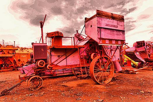 Old wheat harvestor by Jeff Swan