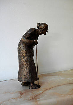 Old woman with a cane  by Nikola Litchkov