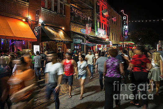 Herronstock Prints - On any typical weekend thousands of party goers walk through 6th