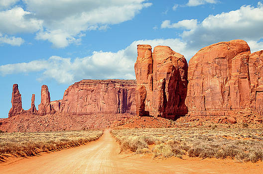 On the road through Monument Valley Panorama by Daniela Constantinescu