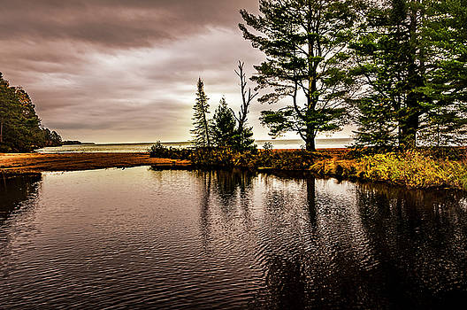 On the Shore of Madeline Island by Lonnie Paulson