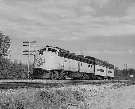 Chicago and North Western Historical Society - Passenger Train Cuts Through Countryside