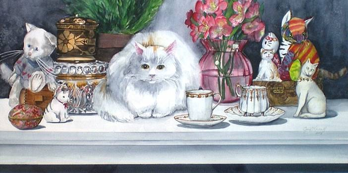 One Real Cat and Several Faux Kitties by Jane Loveall