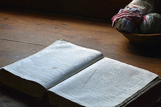 Open Bible on Antique Table with Balls of Scrap Cloth by Bruce Gourley