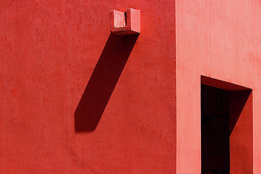 Open Door and Water Outlet on a red wall by Prakash Ghai