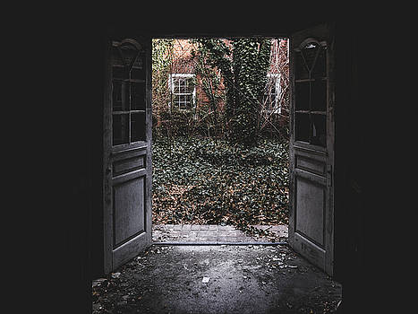 Open Doors in Abandoned Building by Dylan Murphy