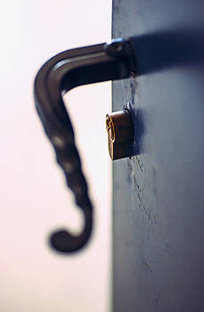 Eduardo Huelin - opened metal door with latch handle closeup