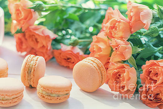 Orange macaroons and fresh little roses by Victoria Kondysenko