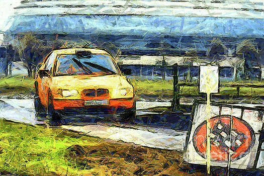 Orange rally car by Magomed Magomedagaev