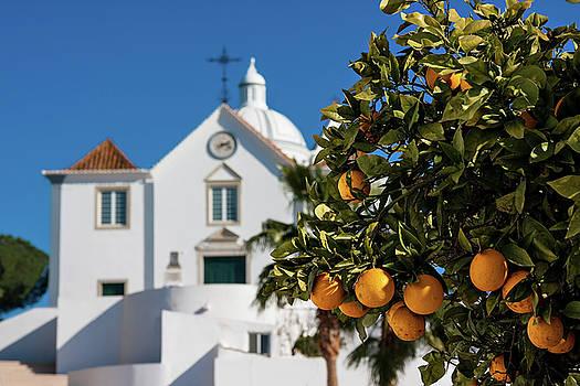 Orange Tree and church - Castro Marim, Portugal by Barry O Carroll