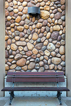 Outdoor Wood Bench by Rock Wall by David Gn