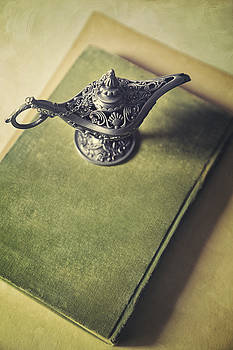 Sandra Cunningham - Over head view of Genie lamp on a book