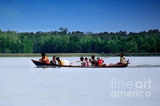 Overcrowded fishing boat by Mirko Dabic