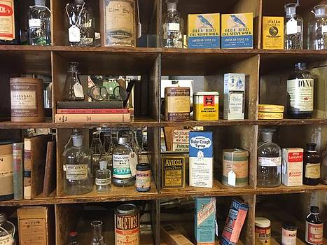 Packed shelves of vintage items for sale.  by Jen Lynn Arnold