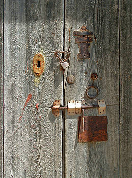 Padlocked door by Mary Attard