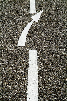 Sami Sarkis - Painted white arrow sign in the dividing line on the road
