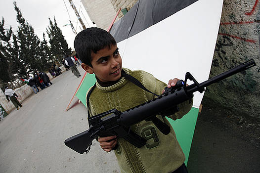 Palestinian Boy Playing with Toy Gun by Jason Moore