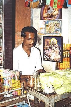 Pan seller, India by Barron Holland