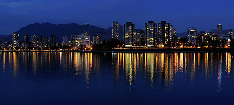 Reimar Gaertner - Panorama of West End Vancouver skyline at dusk reflected in Engl