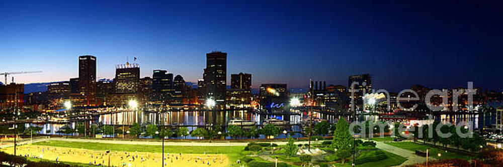 Panoramic View of Baltimore Beach and Inner Harbor at Twilight by James Brunker