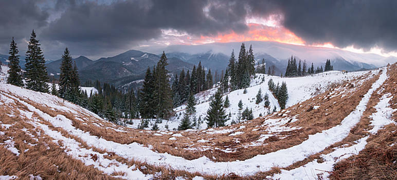 Panoramic view of winter mountains in the evening by Sergey Ryzhkov