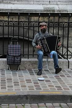 Parisian Musician by Sean Flynn