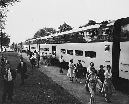 Chicago and North Western Historical Society - Passengers and Train at Depot - 1960