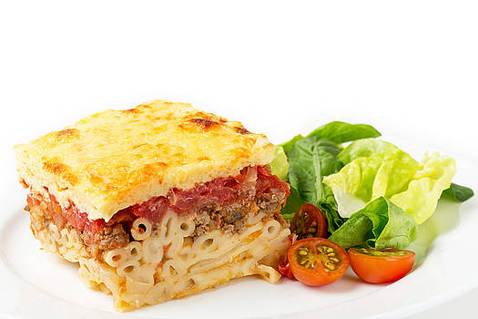 Pastitsio and salad side view by Paul Cowan