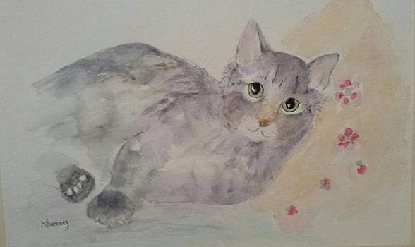Peanut Relaxing On a Pillow by Kathy Sweeney