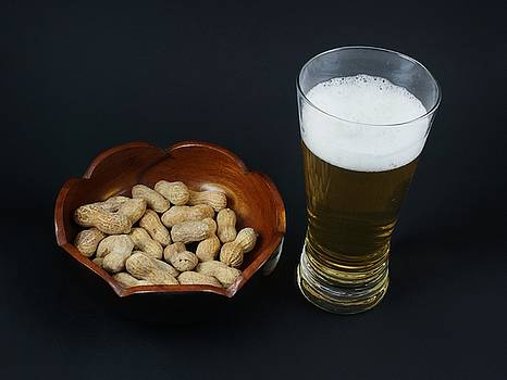 Peanuts and beer. by Robert Rodda