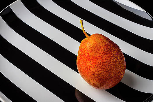 Pear On Striped Plate by Garry Gay