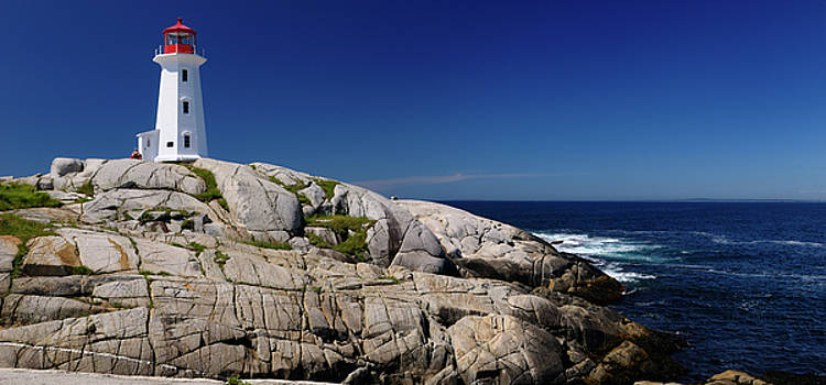 Reimar Gaertner - Peggys Cove Nova Scotia lighthouse on worn granite rocks with ac