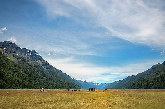 People visiting Elighton Valley in New Zealand. by Daniela Constantinescu