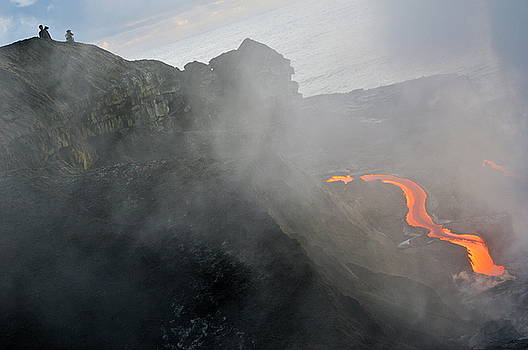 Sami Sarkis - People watching river of molten lava flowing to the sea