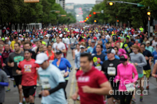 Herronstock Prints - Photo of thousands of runners on Congress Ave at the the Cap 10K in downtown Austin Texas with in camera motion blur