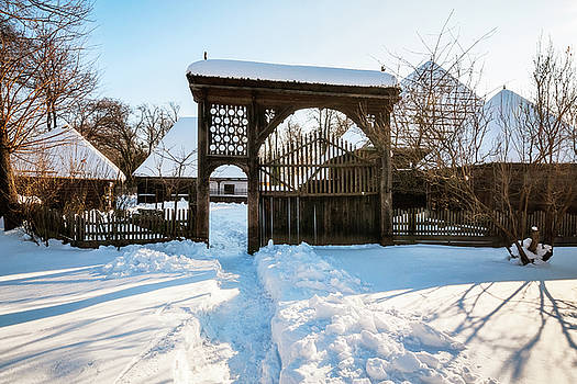 Picturesque winter setting at the Village Museum in Bucharest by Daniela Constantinescu