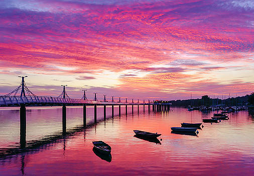 Pier, boats and red sunset by Dmytro Korol