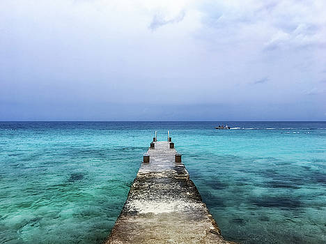 Pier on Caribbean Sea With Boat by Susan Schmitz