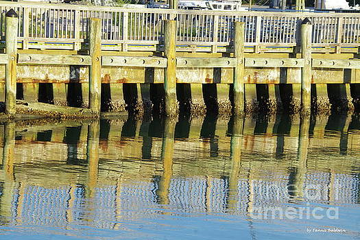 Pier reflection by Tannis Baldwin