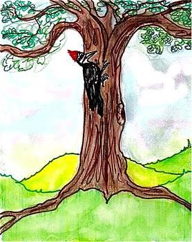 Pileated woodpecker pecks by Carol Allen Anfinsen