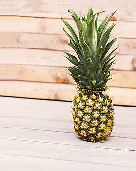 Sophie McAulay - Pineapple on wooden background