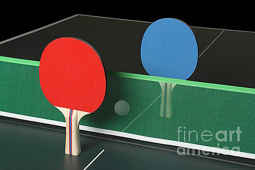 Ping Pong Paddles on Table, standing upright by Jason Kolenda