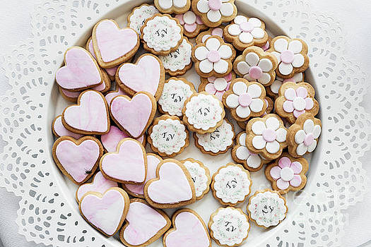 Pink And White Glazed Cookie Biscuits On Tray by Jacek Malipan