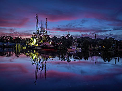 Pink Clouds Frame a Shrimp Boat by Brad Boland