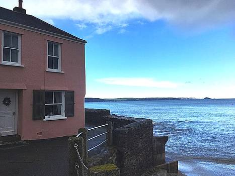 Pink Cottage And Blue Sky by Steve Swindells