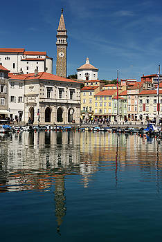Piran Slovenia with inner harbor lined with boats and Tartini Sq by Reimar Gaertner