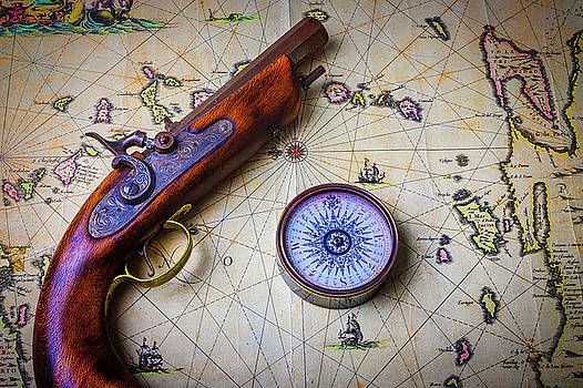 Pistole And Compass On Old Map by Garry Gay